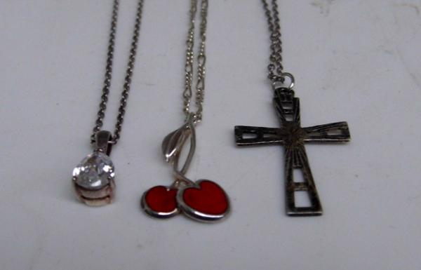 3 silver pendants & chains, incl. cross & cherries
