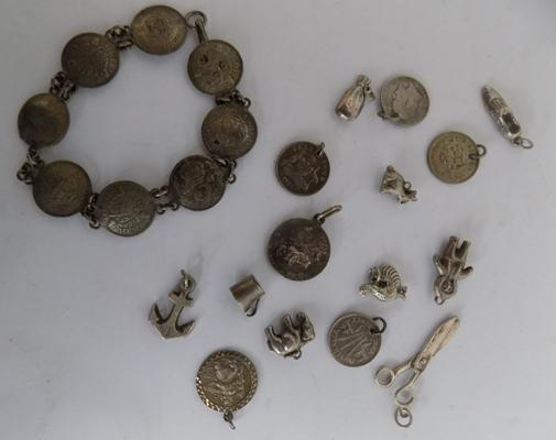 Assorted silver & white metal charms & silver coin bracelet