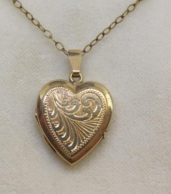 9ct gold locket on yellow metal chain