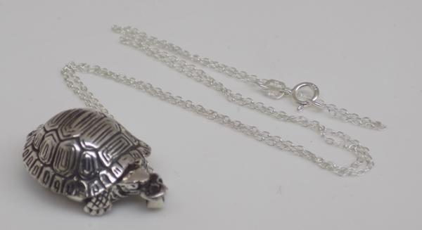 Silver turtle locket on silver chain