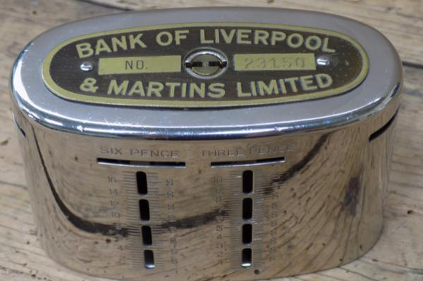 Bank of Liverpool savings bank with coins