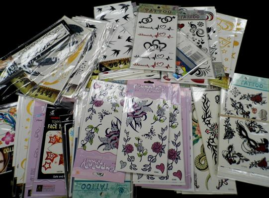 Over 100 sheets of transfer tattoos, mixed designs