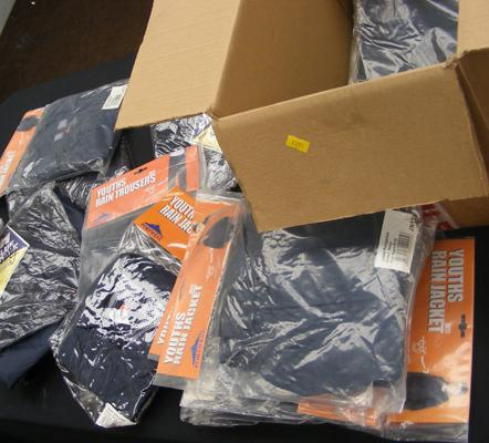 Box of new rain ware - jackets + trousers