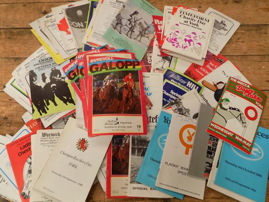 Box of horse racing programmes