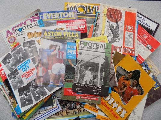 Box of vintage football programmes