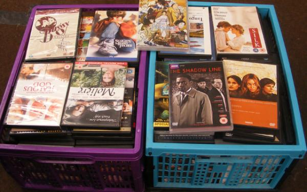 2 boxes of mixed DVDs