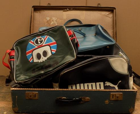 Vintage suitcase containing vintage bags