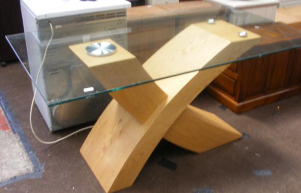 Modern designer glass topped dining table