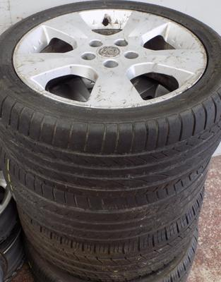 Set of 4 Vauxhall alloys with good tyres