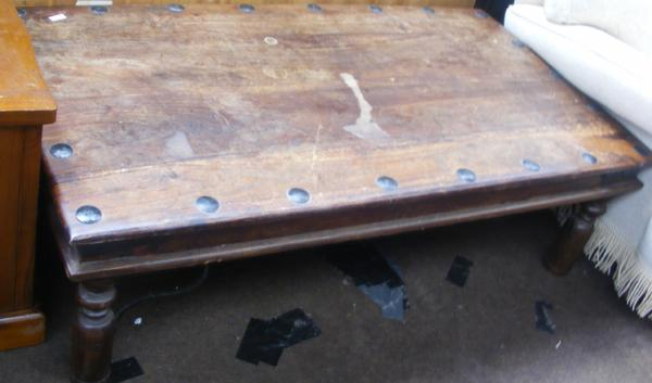 Solid wood coffee table with metal stud accessories
