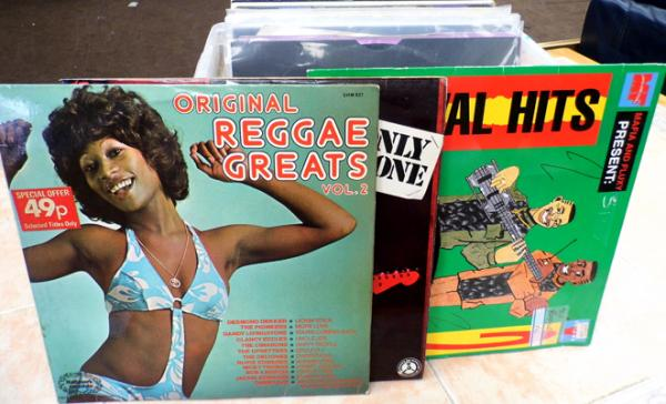 Box of collector's LPs & 12 inch Reggae singles