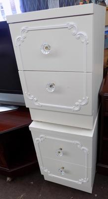 2 cream bedside units