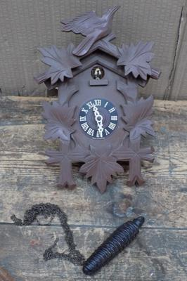 Cuckoo clock with weights (weight in office)
