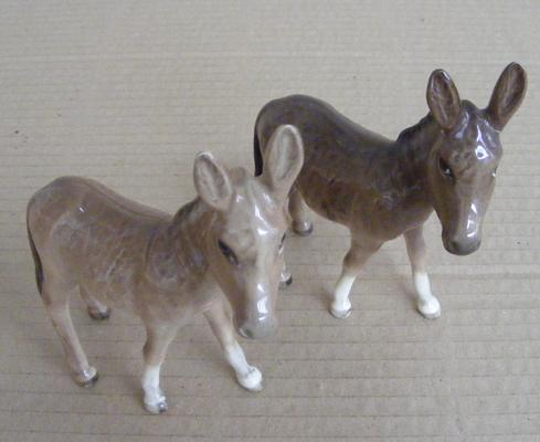 2 John Beswick donkeys, one repaired, one no damage