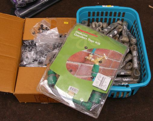 Box of pipe clips, box of garden lines and boxed garden tap