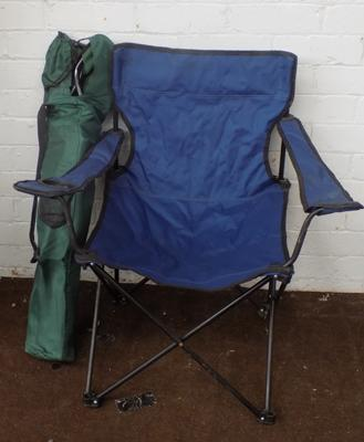 Two folding camp chairs with bags