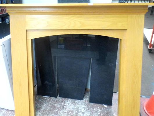 3 piece fireplace, wooden mantlepiece, black marble hearth + marble surround