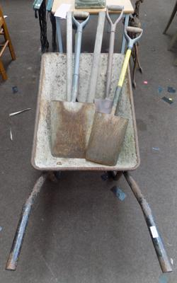 Wheelbarrow and garden tools incl. pick, boig hammer, spade etc.