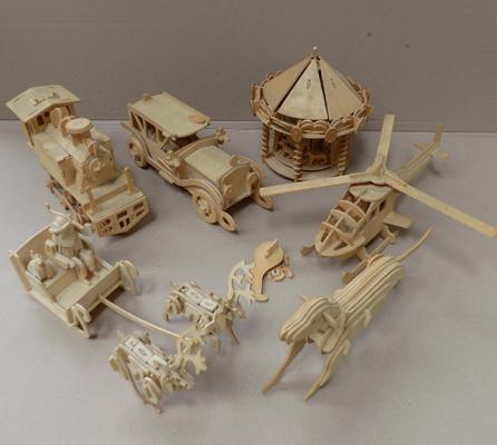 Collection of hand made wooden toys incl. carousel, helicopter etc.