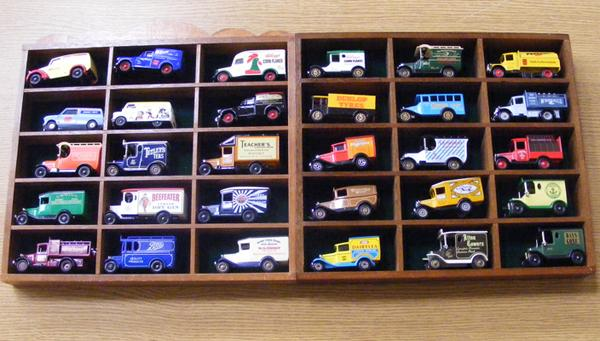 2 collectors cases of vintage diecast advertising vans