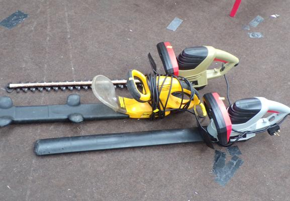 Selection of three electric hedge cutters, as seen