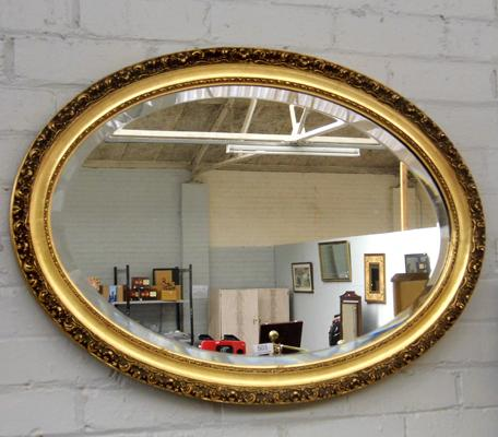Bevel edged oval mirror