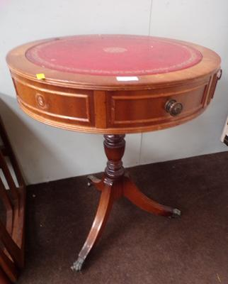 Circular leather topped occasional table
