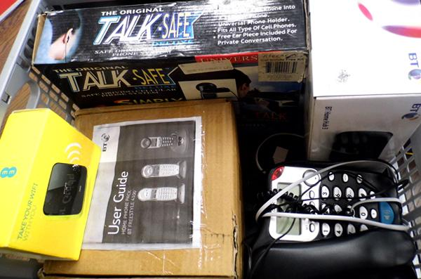 Box of telephones and accessories