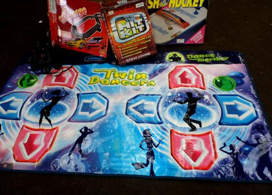 Box of children's activity games incl. table top hockey, dance mat etc.