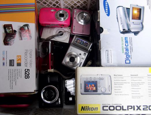 Box of digital cameras and 2 camcorders