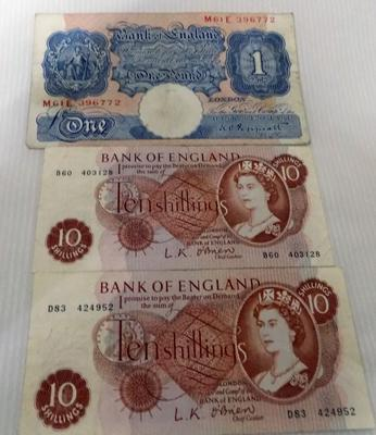 One pound note & two 10 Shilling notes
