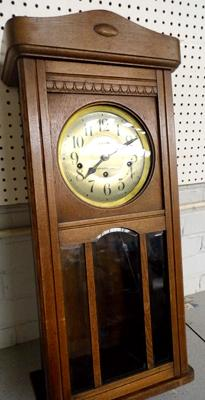 Edwardian solid oak cased wall clock by C Awty, Buckhurst Hill 30x14 inches