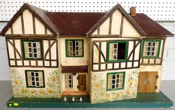 1950's Tri-ang dolls house, fully complete with electrics, tinplate windows, opening rooms 34x12 inches