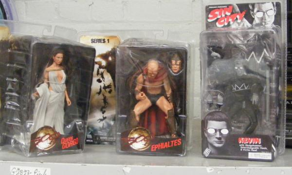 Three sealed '300' & 'Sin City' action figures