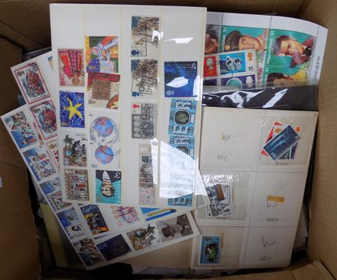 Box of stamps in packets etc