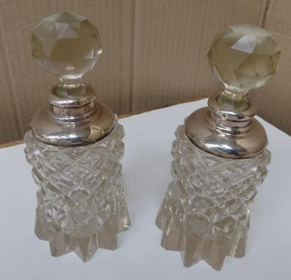 Pair of glass cut silver topped perfume bottles, hallmarks seen but worn, height 6.5 inches