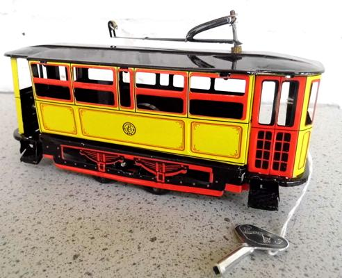 Vintage tinplate clockwork tram with key 8 inches