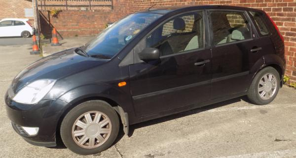 Ford Fiesta 1.4 Ghia MOT 3/7/20, reg 2002, low mileage 93000, low insurance group, 2 keys, 12 stamps in service book, 2 lady owners.