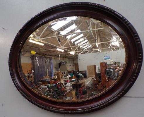 Ornate wooden oval mirror