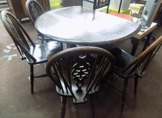 Round table & 4 wheel back chairs