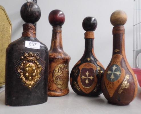 4 leather covered bottles
