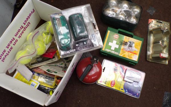 Box of mixed items, incl. camping stove, first aid kit, boules, door alarm & jointing clamp