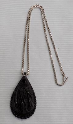 Antique Whitby jet pendant on silver box chain (20 inches)