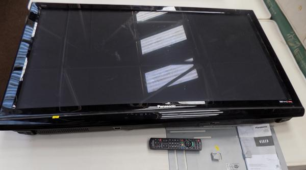 50 inch Panasonic TV with remote (in office) w/o no stand