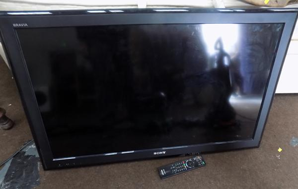 Sony Bravia 40 inch flatscreen TV (no stand) with remote (in office) w/o