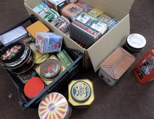 Two boxes of assorted collectable tins