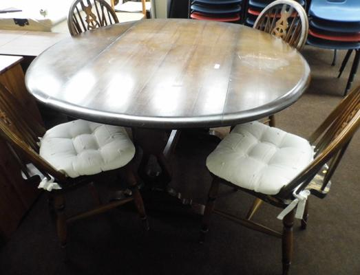 Drop leaf table & four wheel back chairs