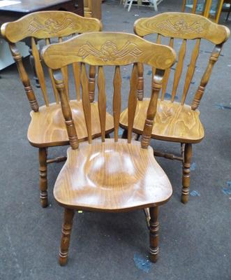 Three carved back oak chairs