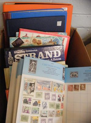Large box of 13 stamp albums