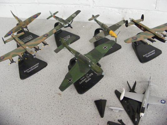 Collection of model planes on stands, some at fault - WWII era